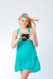 Blonde girl in a summer dress with retro photo Royalty Free Stock Photography