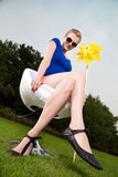 Blonde girl with sunglasses and a pinwheel Royalty Free Stock Photos
