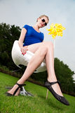 Blonde girl with sunglasses and a pinwheel Stock Images