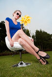 Blonde girl with sunglasses and a pinwheel Stock Photos