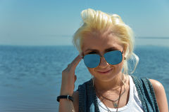 Blonde girl with sunglasses Stock Image