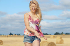 Blonde girl in sunny autumn field Royalty Free Stock Photography