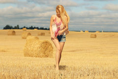 Blonde girl in sunny autumn field Royalty Free Stock Photos