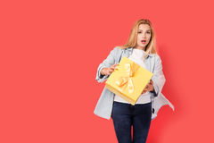 Blonde girl is surprised by gift. Box Stock Images