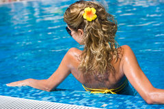 Blonde girl in swimming pool Royalty Free Stock Images