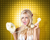 Blonde girl tangled in a funny phone communication Stock Image