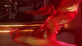 Blonde girl in theatrical costume with wings dances and turns stock footage
