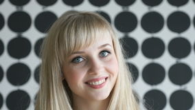 Blonde girl with a thick hair smiling for camera stock video footage
