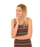 Blonde girl thinking Stock Photography
