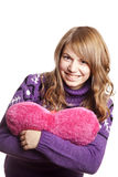 Blonde girl with toy heart Stock Photography