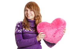 Blonde girl with toy heart Stock Photos