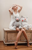 Blonde girl with toys Stock Image