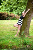 Blonde girl by the tree Royalty Free Stock Photography