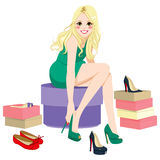Blonde Girl Trying Shoes Royalty Free Stock Photos