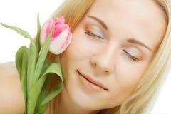 Blonde girl with tulip Stock Photos