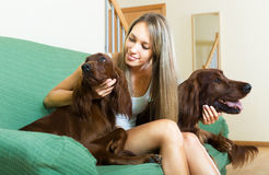 Blonde girl with two dogs Royalty Free Stock Photos