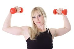 Blonde girl with two weights Royalty Free Stock Photo