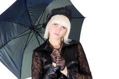 Blonde girl with an umbrella Stock Images