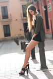 Blonde girl urban background Stock Image