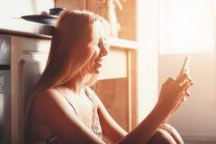 Blonde Girl Using Smartphone royalty free stock photo