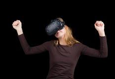 Blonde girl using VR - virtual reality headset Royalty Free Stock Photos