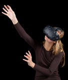 Blonde girl using VR - virtual reality headset Stock Images