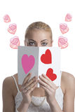 Blonde girl with valentine postcard forward the face Stock Images