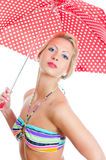 Blonde girl with vintage spotted umbrella Royalty Free Stock Photography