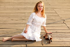 The blonde girl with a violin outdoor Royalty Free Stock Images