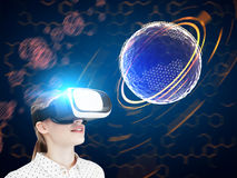Blonde girl in VR glasses, futuristric orb Stock Images