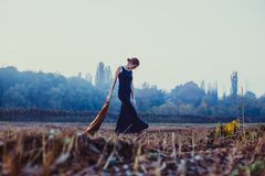 Lonely girl on a walk. Blonde girl walks lonely on the waste ground. The concept of depression Royalty Free Stock Photography
