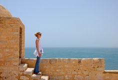 Blonde girl on wall of old castl  1 Stock Images