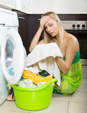 Blonde girl and washing machine Royalty Free Stock Photos