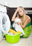 Blonde girl and washing machine Royalty Free Stock Photo