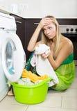 Blonde girl and washing machine Royalty Free Stock Photo