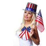 Blonde Girl waving Small American Flag isolated on white. Independence day. Patriotic Young Woman Stock Images