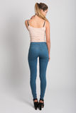 Blonde girl wearing blue jeans and t-shirt. Studio shot Royalty Free Stock Photo