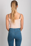 Blonde girl wearing blue jeans and t-shirt. Studio shot Royalty Free Stock Photography