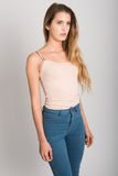 Blonde girl wearing blue jeans and t-shirt. Studio shot Stock Photography