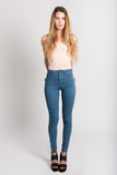 Blonde girl wearing blue jeans and t-shirt. Studio shot Royalty Free Stock Photos