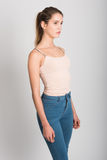 Blonde girl wearing blue jeans and t-shirt. Studio shot Stock Photos