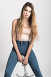 Blonde girl wearing blue jeans and t-shirt. Studio shot Stock Photo