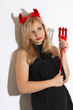 Blonde girl wearing a costume of an imp. Blonde girl wearing a red costume of an imp Royalty Free Stock Photography