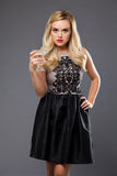 Blonde girl wearing evening dress drinking martini Royalty Free Stock Photos