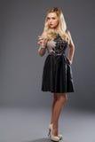Blonde girl wearing evening dress drinking martini Royalty Free Stock Photo