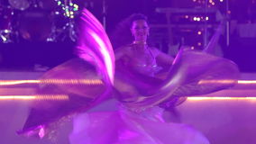 Blonde girl wearing gold theatrical costume with wings dances stock video