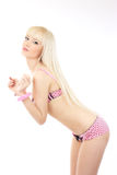 Blonde girl wearing pink lingerie with handcuffs Stock Photography