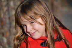 Blonde Girl Wearing Red Toggle Jacke stock photo