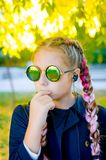 Blonde girl wearing a sunglasses with pink kanekalon in hair in royalty free stock photos
