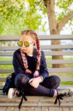 Blonde girl wearing a sunglasses with pink kanekalon in hair in stock images